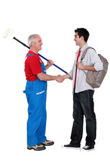 Decorator welcoming a new apprentice