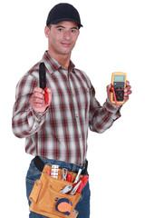 Craftsman with tweezers and voltmeter