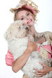 woman in lady costume holding a dog