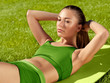A beautiful sporty woman  doing stretching exercise against natu