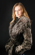 Attractive woman in fur coat