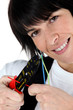 Woman cutting wire with special tool