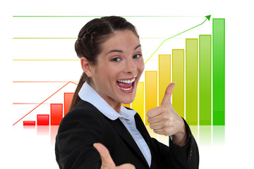 Excited businesswoman giving the thumbs-up