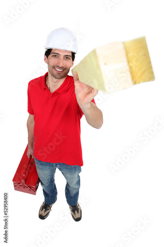 Young worker, standing isolated on white background