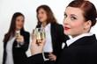 Three businesswomen toasting success