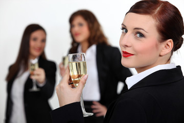 Three businesswomen toasting success