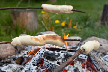 bread on a stick over a fire