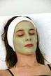 Woman receving facial at day spa