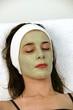 Woman receving facial at day spa