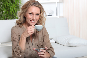 Blonde woman with coffee