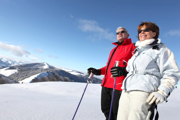 senior couple skiing