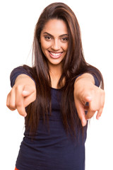 Smiling mix race woman pointing finger forward