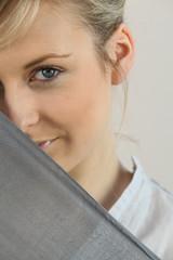 Shy girl behind scarf