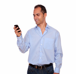 Hispanic adult man calling on cellphone