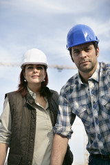 Male and female construction workers