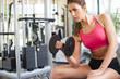 Girl working hard at gym