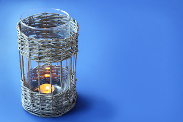 Vintage wicker lamp with a candle on the eve