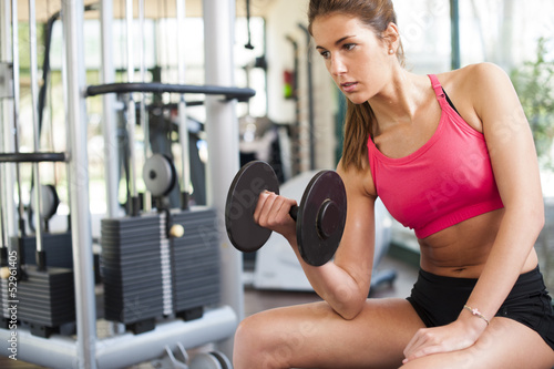 Girl working hard at gym