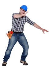 Builder shielding himself