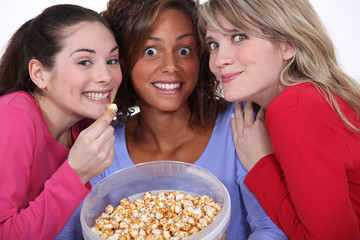 Peppy women eating popcorn