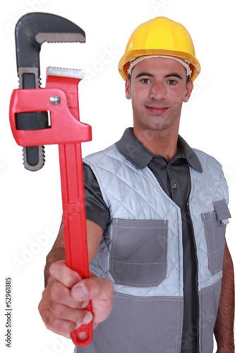plumber showing spanner