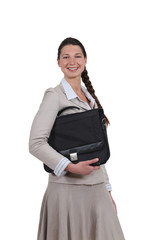 Young business professional carrying a briefcase