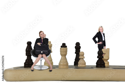 Two women on giant chessboard