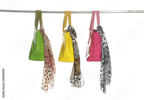 silk scarf and three colorful bag on a hanger