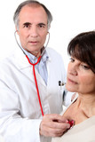 Doctor listening to a woman's chest
