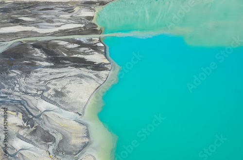 Detail aerial view of river flowing into mountain lake