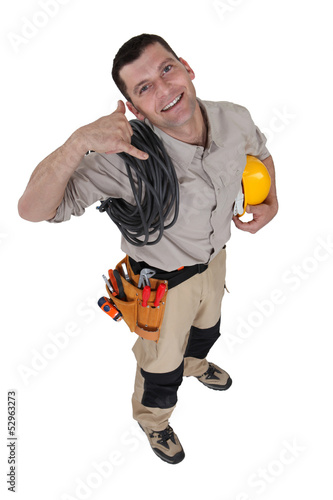Electrician making a phone gesture