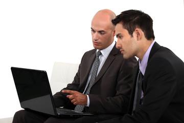 Associates discussing their business plan