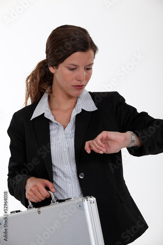 Businesswoman checking watch