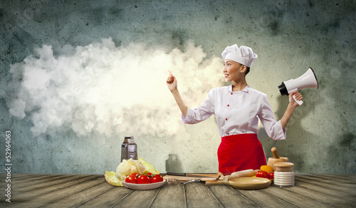 Asian female cook holding megaphone