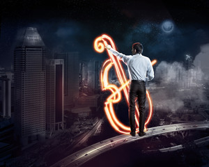 Businessman draws a glowing signs