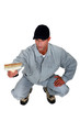 craftsman painter kneeling and holding a brush