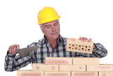 Bricklayer laying bricks