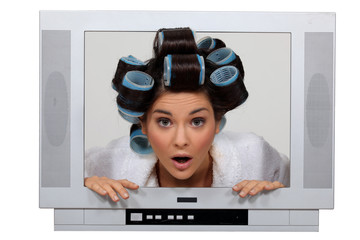 woman in tv set with hair curlers