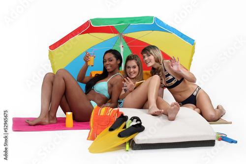 Three women having at the beach