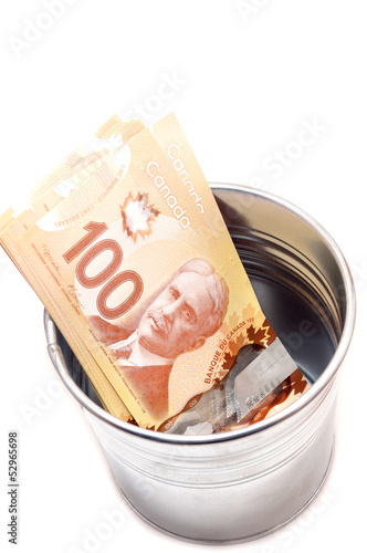 Hundred Canadian dollar bills in a pot