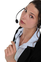 A businesswoman with a headset on.