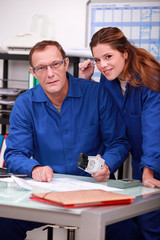 Tradespeople working together in the office