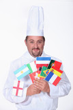 a chief cook holding a lot of foreign flags