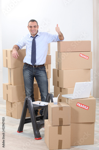 Man surrounded by cardboards