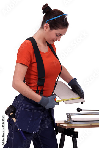 Woman cutting a tile
