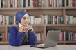 Beautiful muslim girl study with laptop at library