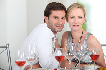 Couple sat at table
