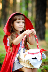 """girl sits on hemp with a basket looking away."""" Red Riding Hood"""""""
