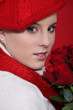 Woman in a red beret with red roses