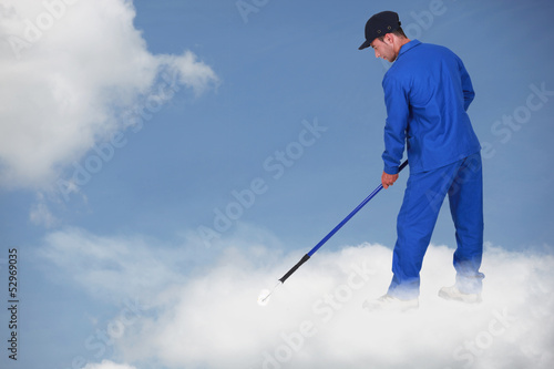 Photomontage of a worker on a cloud